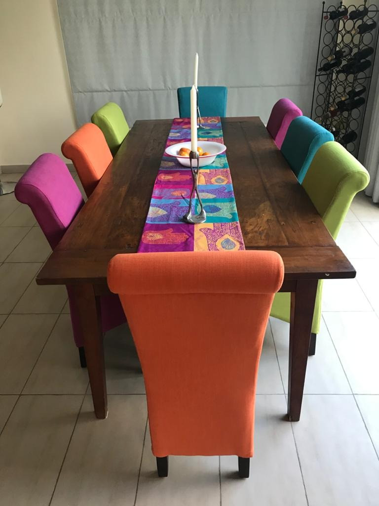 Upholstered dining chairs in different colors